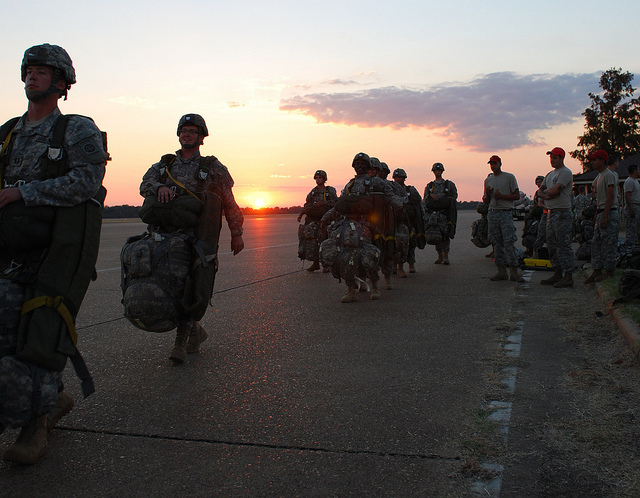 "Soldiers from the 82nd Airborne Division, Fort Bragg, N.C., prepare to board C-130s for a night jump. (photo by Air Force Capt. Paradon ""Sil"" Silpasornprasit, 615th Contingency Response Wing)"